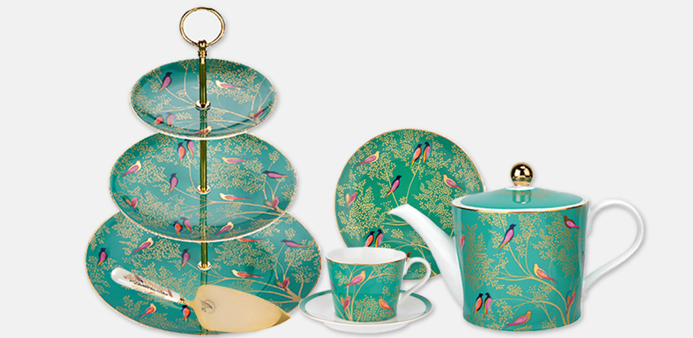 The Chelsea Collection with Green Birds design. Products are a teapot,  teacup and saucer, cake plate, cake slice and cake stand.
